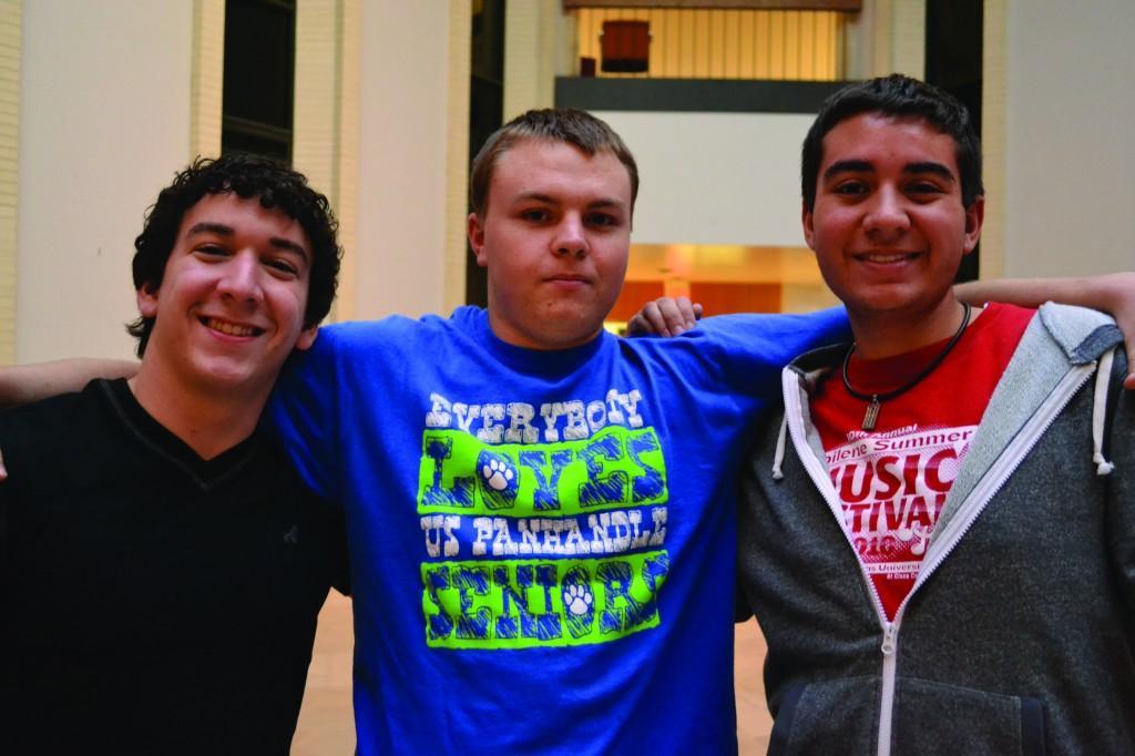 Joey DeLaGarza (freshman), Nick Stephens (sophomore) and Matthew Molinar also help with recital set up. Photo by Alex Montoya.