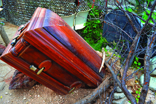 A coffin buried in the ground adds to the scary atmosphere. Photo by Alex Montoya.