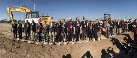 West Texas A&M University president, Dr. Walter Wendler, is flanked by numerous officials and dignitaries at the new Agricultural Sciences Complex
