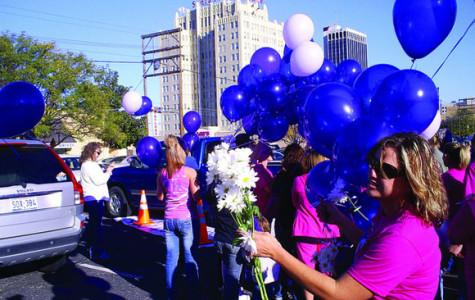 Family support services host march against domestic violence