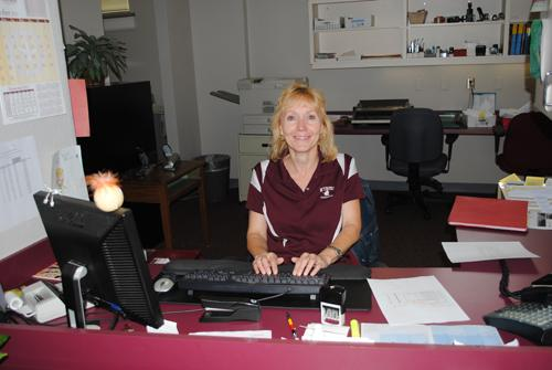 Marga Gore working at the Financial Aid Office. Photo by Lisa Hellier.