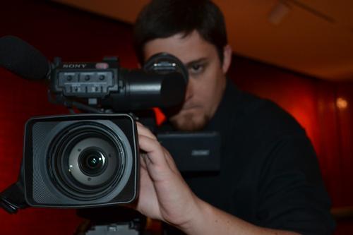Brandon Newburg recording the show. Photo by Alex Montoya.