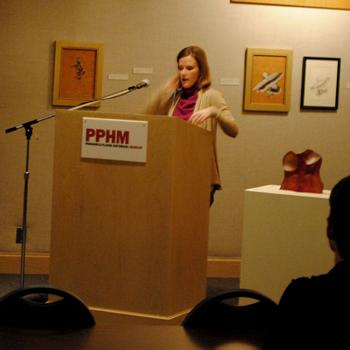 Dr. Amy Von Lintel speaking about the history of feminism. Photo by Lisa Hellier.