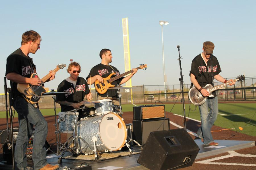 (L to R) Lead guitar player Ben Cargo, drummer Jordan McClain, bass player Steven Ronk and AJ Swope performing in the Lady Buffs Sports Yard. Photo by Daniela Fierro.