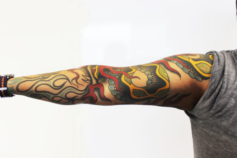 Reporter Jonathan Espinoza shows us his tattoos. He has more on his other arm and on both legs