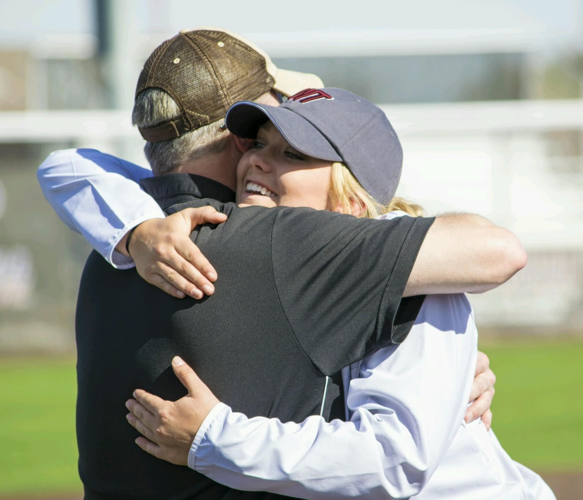 An elated Lacey Taylor hugs her father.