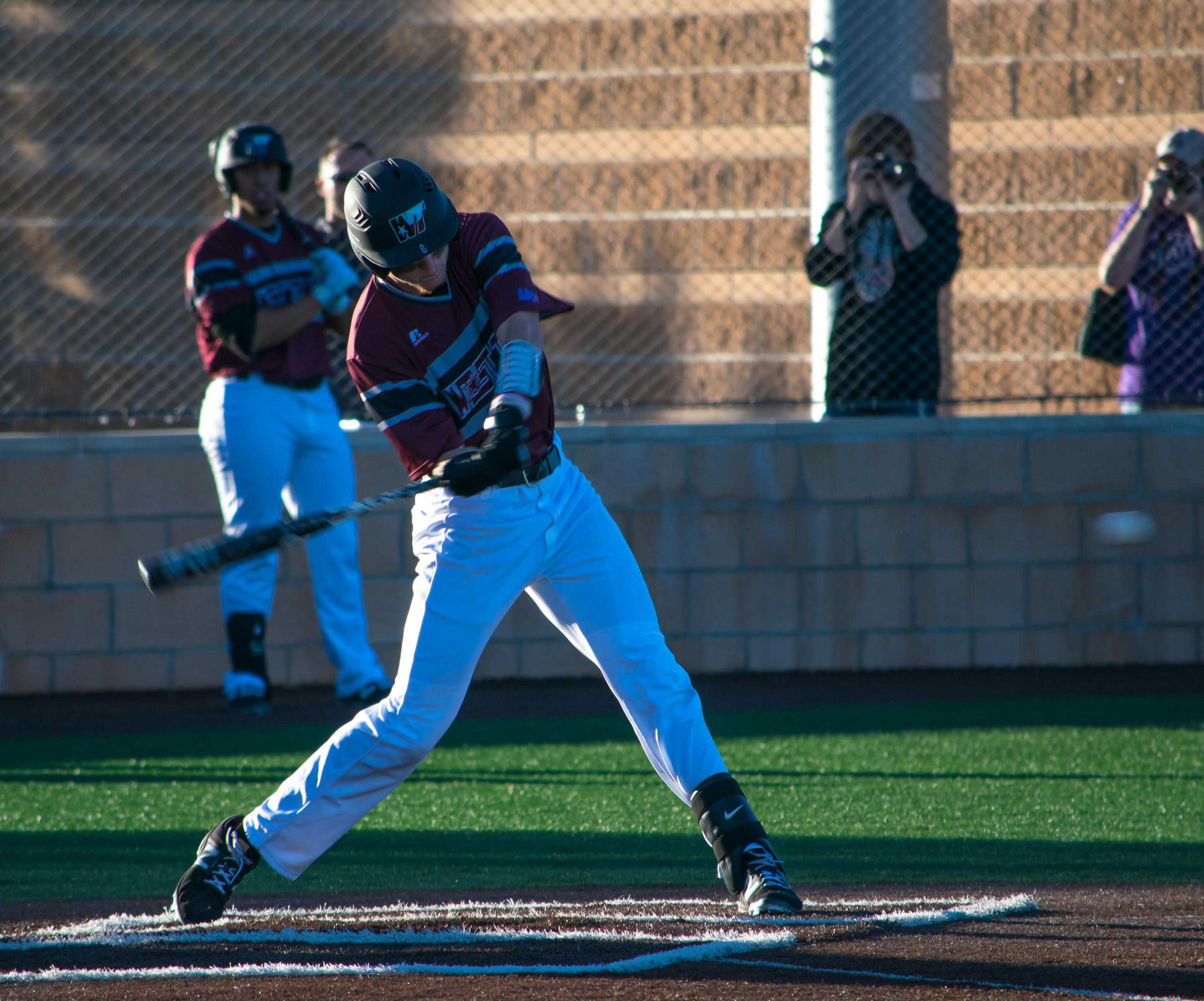 Adam Adkins takes a swing for the WTAMU Buffs.