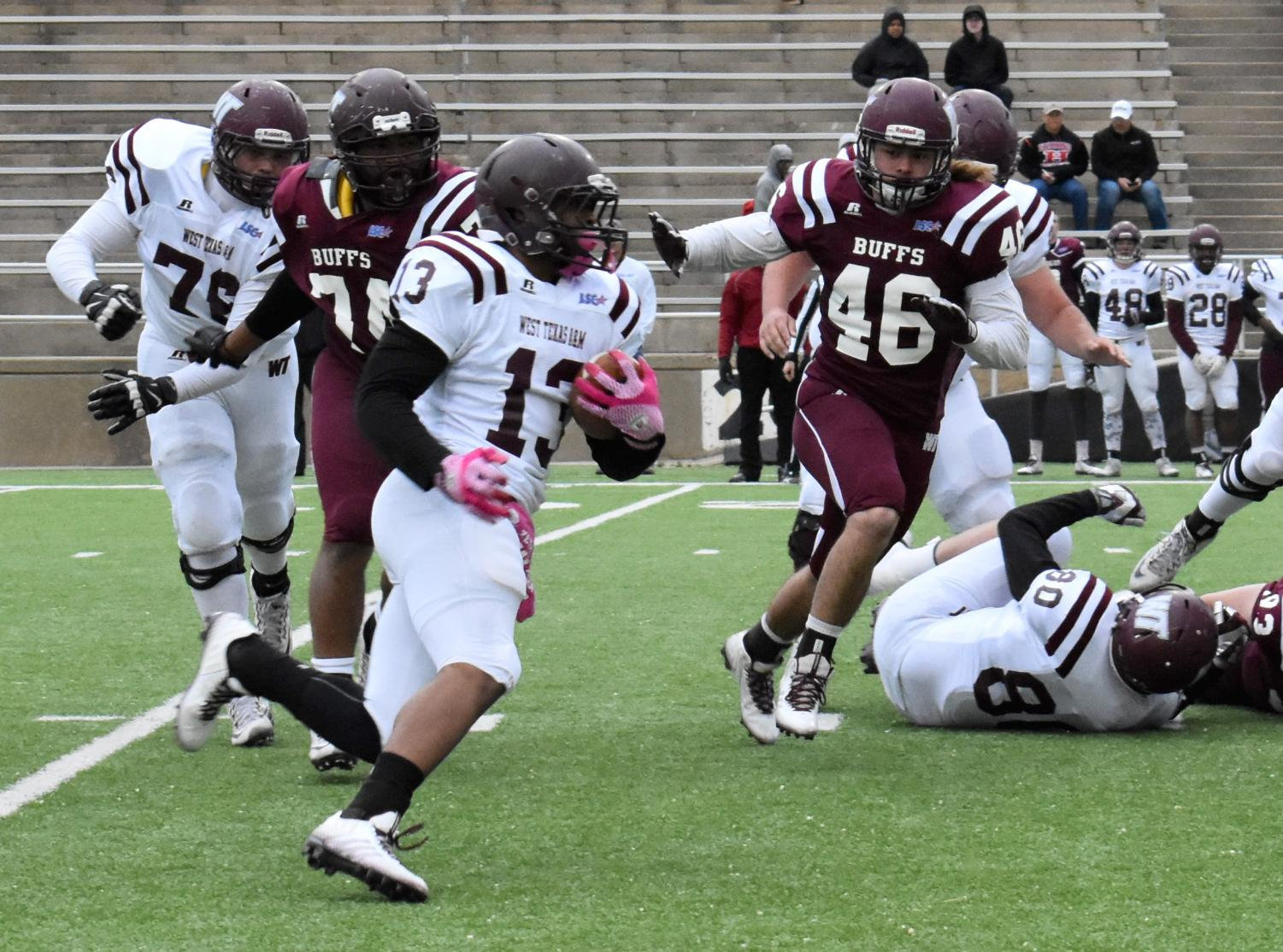 Running back Eddy Williams runs as WT defenders chase down Williams during the annual Maroon and White spring game at Kimbrough Memorial Stadium on Friday, April 20.