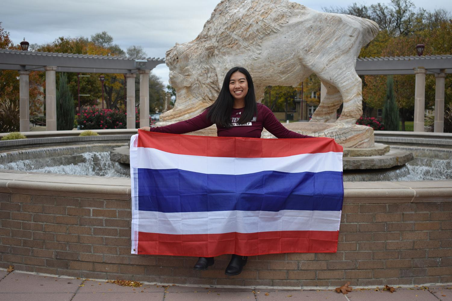 International student and junior electronic media major Loukyee Songprasert holding the Thailand flag. This flag is something that she keeps to remind her of home.