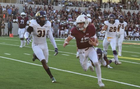 Quarterback, Nick Gerber runs in for a touchdown.