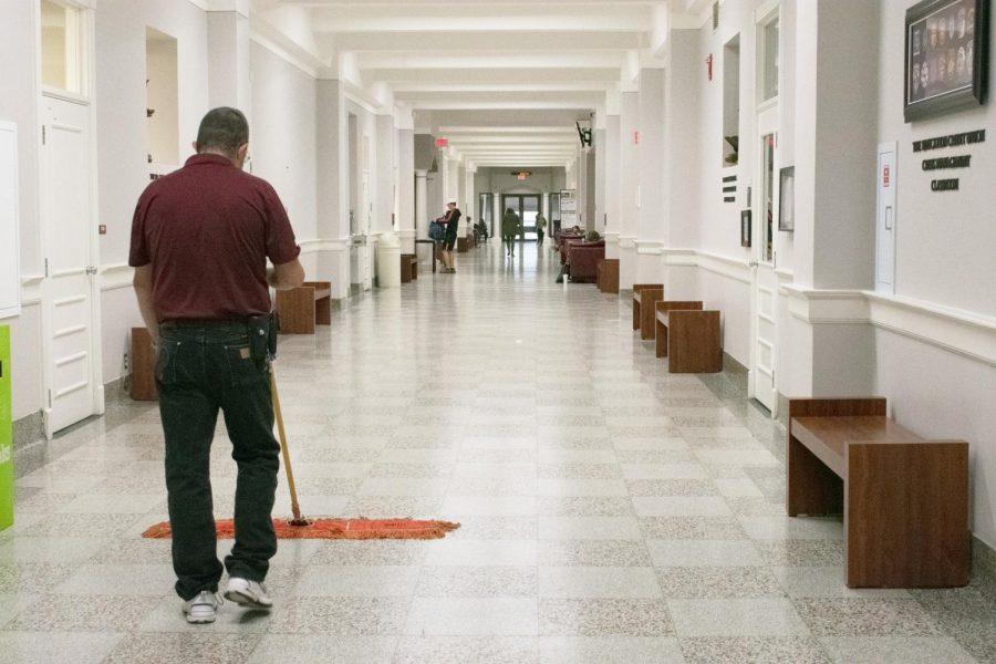 Bill Thurston keeping Old Main clean.
