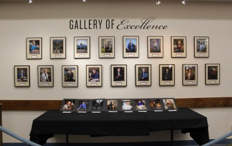 Savannah Wesley/The Prairie News The Gallery of Excellence is displayed in the Cornette Library next to the circulation desk.