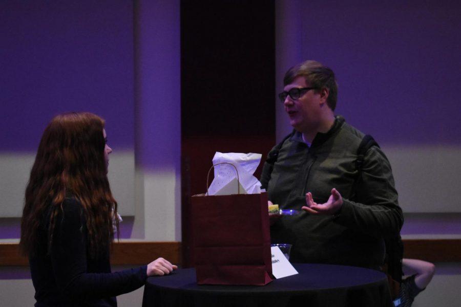WTAMU student Christian Nicholson speaks to Randall High School English teacher Callie Shipley.