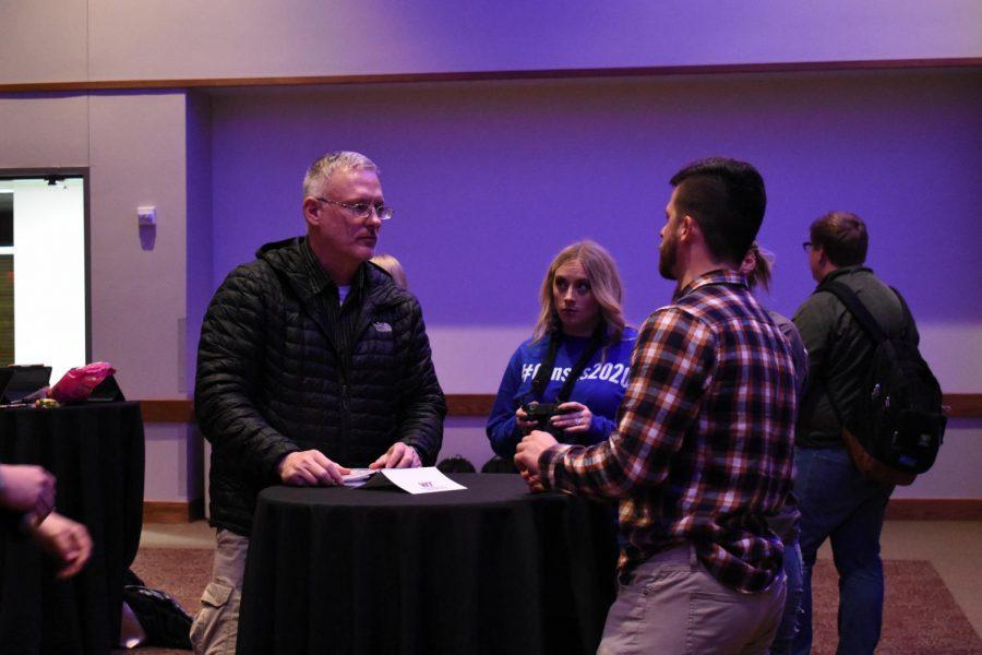 Dr. Michael McFarland and senior digital communications major Katy Zimmerman speak to NFL associate producer Guy Brown.