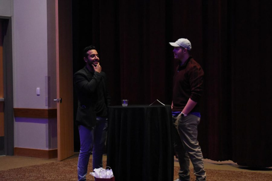 Senior digital communications major Cody Stephens speaks to stand-up comic and marketing coordinator of Exceptional Emergency Center Saúl Rodriguez.