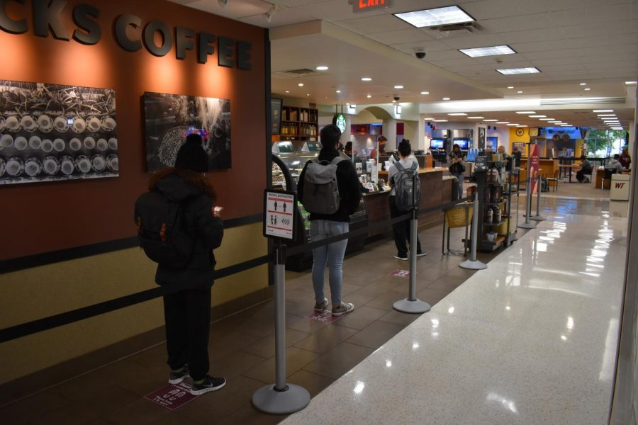 Socially distanced students wait for their coffee at the Jack B. Kelley Student Center
