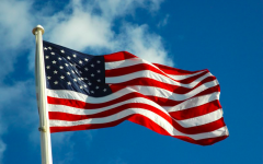The American flag waving proudly in the wind.