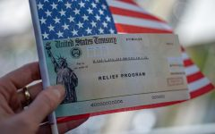 A picture of a relief program check on the United States' flag