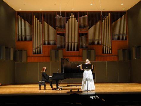 Emily Boschen playing during her junior flute recital alongside her piano accompanist Jessica Xylina Osborne.