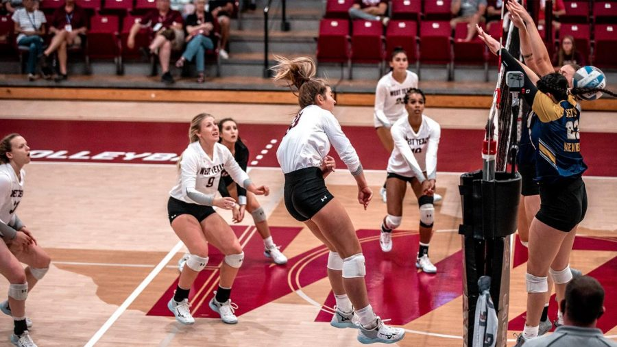 Lady Buffs with a spike for a point