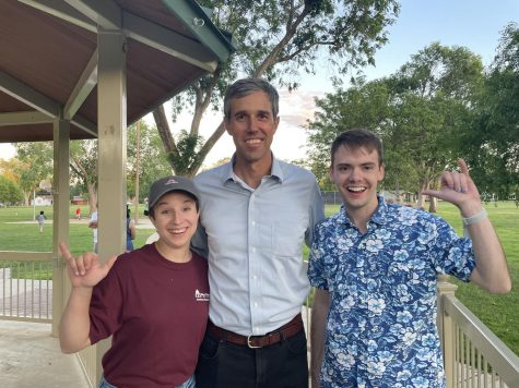 Madelyn Eatley and Marcus Rogers visit with Beto while throwing the Buff hand sign at an event in Lubbock for expanding voting rights in the summer of 2021.
