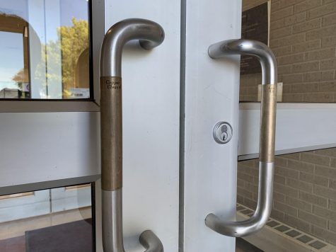 Copper Clean patches sit on the east entrance door handles to the Sybil B. Harrington Fine Arts Comple